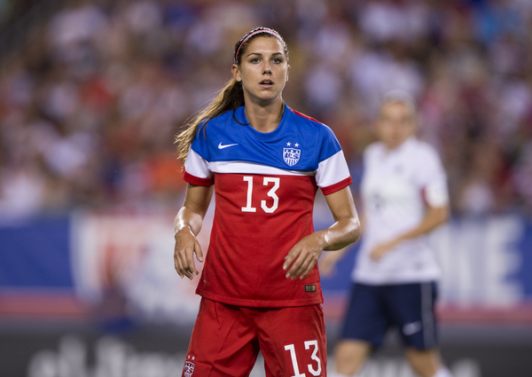 Alex-Morgan-standing-2014-away-kit-ISI