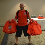 WA Matt Moran with team bags  |  K Jones-Com Dir RIV