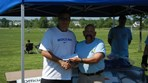 Boys U12 Tsunami Bayport SC $2000 check presented to Coach Berlingieri