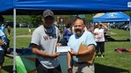 Girls U13 99 Patino OMM  World Class Winner $2000 check presented to Coach Patino