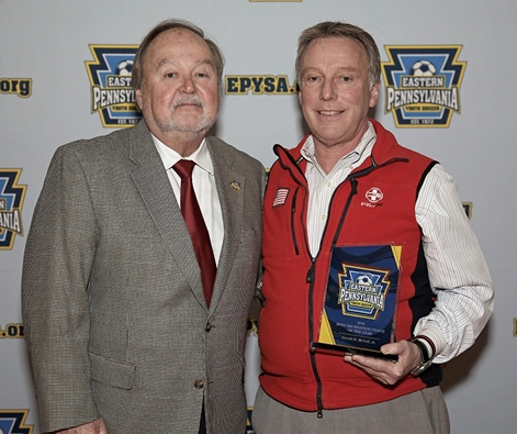 Eastern Pennsylvania Youth Soccer President Jim Kuntz poses with Boys Recreational Coach of the Year Gerald B. McCall, Jr.
